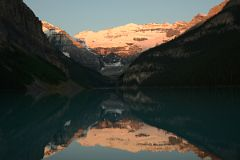 First Rays Of Sunrise Burn Mount Victoria Yellow Orange Reflected In The Still Waters Of Lake Louise