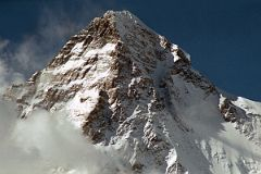 The K2 West Face shines in the late afternoon sun from Concordia. The K2 West Ridge is on the far left. The Southwest Pillar separates the sunny west face from the K2 South Face. The Great Serac is just in shadow to the right below the K2 Summit. The K2 Shoulder is farther down to the right, partially in the sun. The K2 West Ridge was first climbed by Japanese Eiho Otani and Pakistani Nazir Sabir, reaching the K2 summit on August 7, 1981.