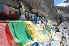 I did a full circle from where I stood to admire the panorama (11:36). Prayer flags drape some of the 13 Golden Chortens on Mount Kailash South Face in Saptarishi Cave. This view leads to the Nandi Pass with just a bit of Nandi on the right.