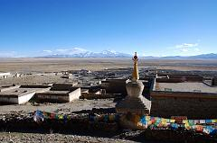 I climb up above the chorten and mani wall on the northern edge of Darchen for a view of the village and the Barkha Plain stretching to Gurla Mandhata.