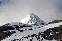 About 30 minutes from the end of the descent from the Dolma La, a valley comes down from the Khando Sanglam La to join the main trail. This valley provides the only glimpse of the Eastern or crystal Face of Mount Kailash. The Kailash South Face is to the left and the North Face is to the right.