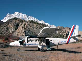 Royal Nepal Airlines plane sits on the gravel at Hungde airstrip as I return from Manaslu