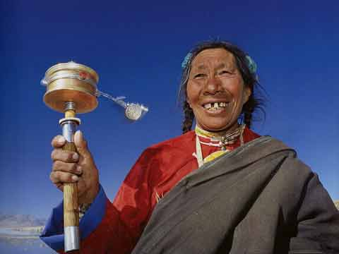 Pilgrim Woman Spinning Prayer Wheel At Lake Manasarovar - Buddhism: Eight Steps To Happiness by Dieter Glogowski book