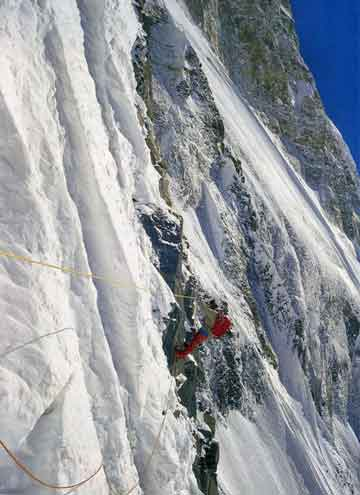 Ian Clough traversing the fixed ropes on the steepest part of the Ice Ridge on Annapurna South Face in 1970 - Annapurna South Face book cover