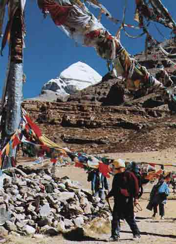 Robert Thurman circling the Tarboche Pole with Kailash in the background - Circling the Sacred Mountain: A Spiritual Adventure Through the Himalayas book