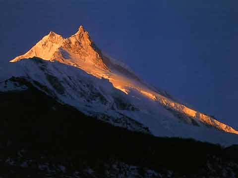Manaslu sunrise from south at Sama - Climbing The Worlds 14 Highest Mountains book