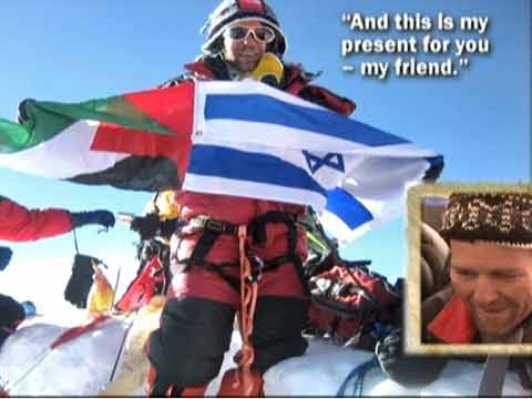 Dudu Yifrah holding Palestinian and Israeli flags on Everest Summit May 18, 2006 - Everest: A Climb for Peace DVD