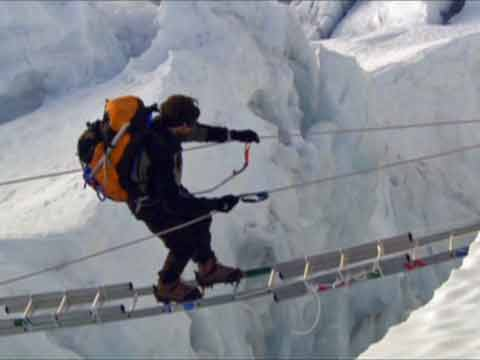Erik Weihenmayer very slowy crossed ladders over a crevasse in the Khumbu Icefall - Farther Than The Eye Can See DVD