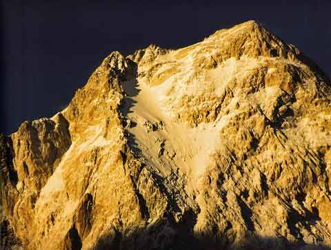 Gasherbrum IV West Face Summit section glows at sunset - Himalaya Alpine Style: The Most Challenging Routes on the Highest Peaks book