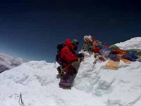 Jamling Tenzing Norgay putting pictures of his family and the Dalai Lama on the Everest summit May 23, 1996 - IMAX Everest DVD
