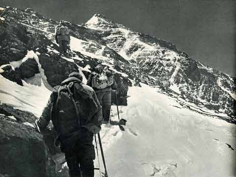 Proceeding cautiously on a snow-covered rocky slope at 8000m on Everest North Face First Ascent 1960 - Mountaineering In China book