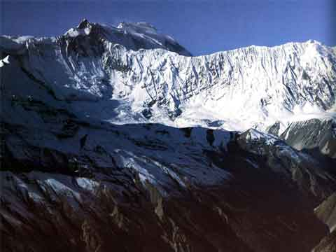 Annapurna East, Central and Main summits peak above the Grande Barriere -  - Over the Himalaya book