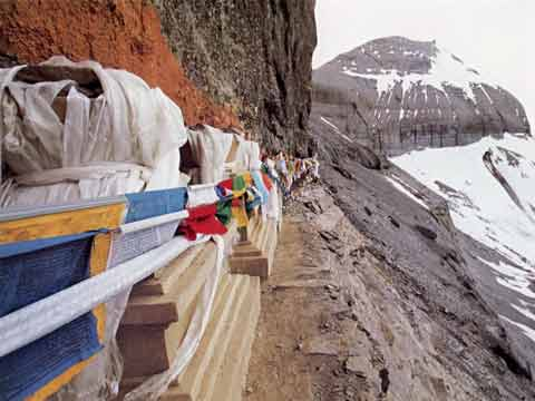The 13 Golden Chortens are chisseled out of a rock face at about 5944m on Kailash Inner Kora - Sacred Landscape And Pilgrimage in Tibet book