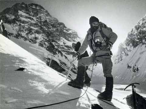 Nick Estcourt on the way to Camp 1 at sunrise with K2 West Ridge behind in 1978 - Savage Arena book