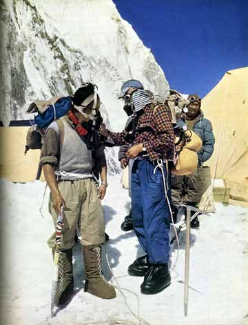 Edmund Hillary, wearing his inimitable hat and check shirt, is turning on the oxygen for Tenzing Norgay as they prepare to leave base camp for the summit of Mount Everest. - The Picture Of Everest book