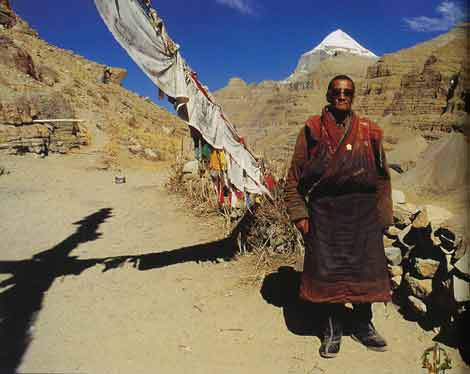 Pilgrim at Tarboche with Kailash behind - The Rivers of the Mandala: Journey to the Heart of Buddhism book