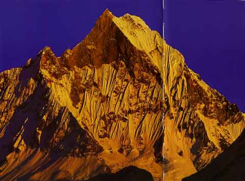 Machapuchare blazes at sunset - Trekking in Himalayas book