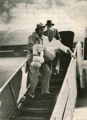 Lionel Terray carrying Louis Lachenal from airplane on return from Annapurna 1950 - True Summit: What Really Happened On The Legendary Ascent Of Annapurna book