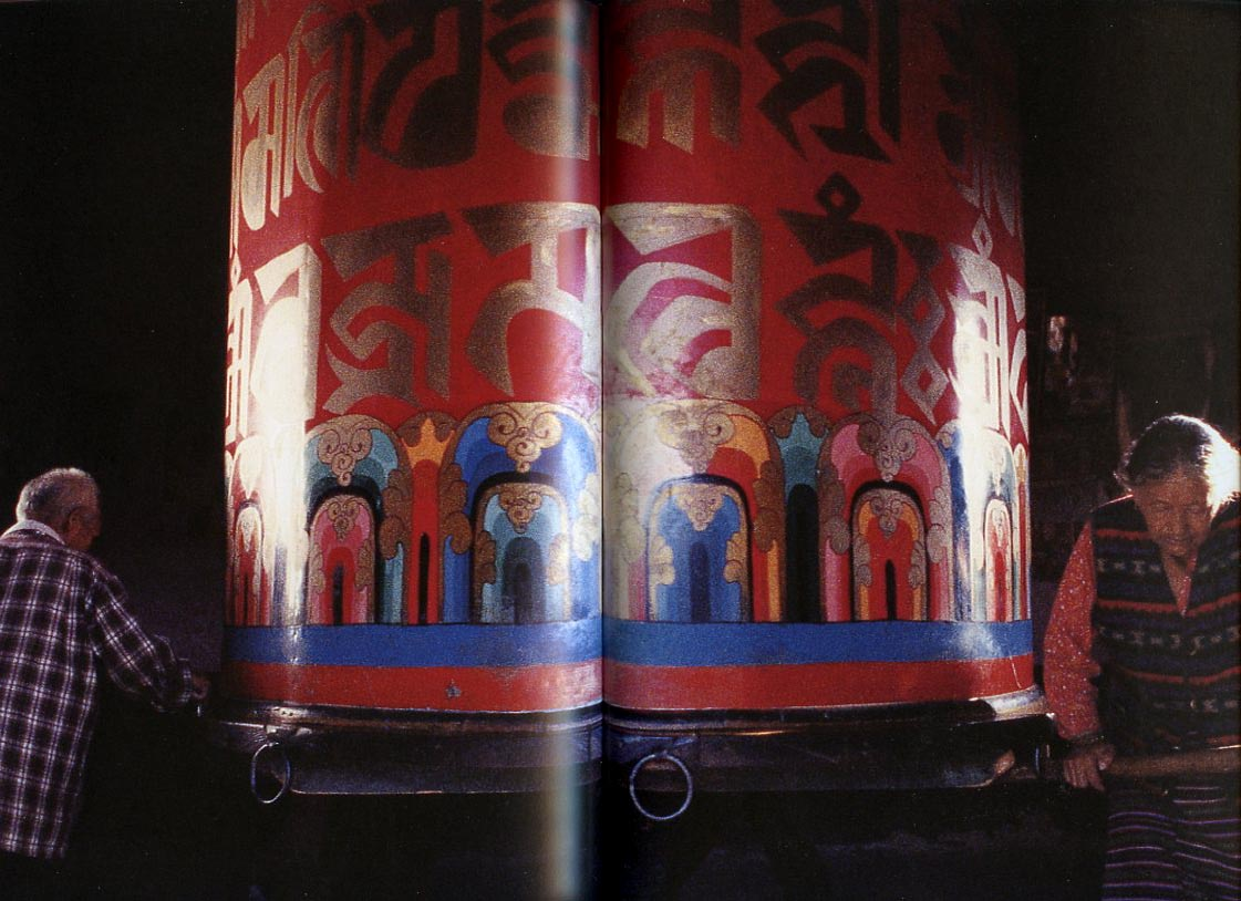 buddhist general reference books tibetan buddhist life book cover pilgrims turning large prayer wheel tibetan buddhist life book
