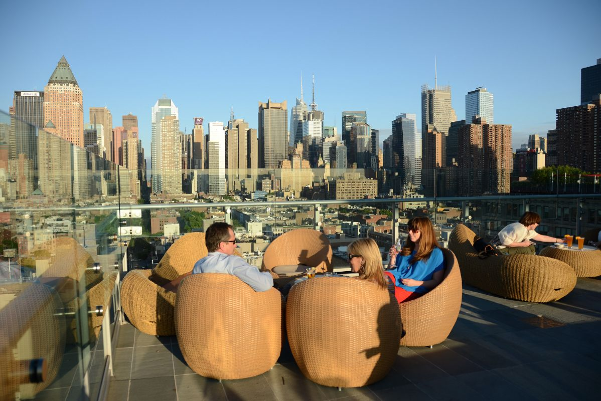 03 Enjoying The Ink48 Hotel Rooftop Bar With New York Manhattan Skyline  Behind
